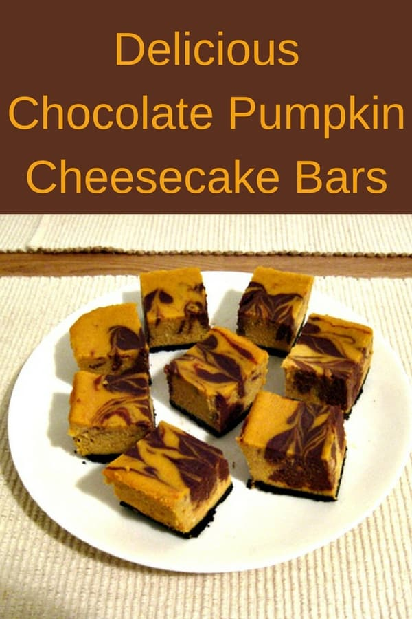 These rich chocolate pumpkin cheesecake bars, made with yummy Oreo cookie crust and semi-sweet chocolate combined with creamy pumpkin and cream cheese are a hit at our house. Perfect for a make-ahead dessert for the holidays or a special birthday. #recipes #Healthy #Dessert #pumpkin #chocolate #snack #cooking #simple #mealprep #Easy