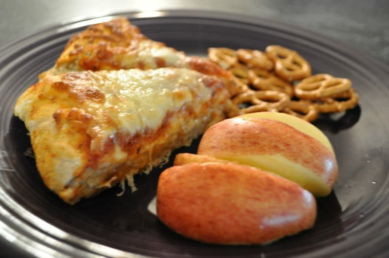 Cheese pizza slices and apples