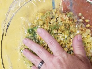 HOW TO STORE AVOCADO CORN SALAD FOR BEST FRESHNESS. This process limits the amount of air that reaches the surface of the avocado. That is important because the air triggers the darkening process.  RecipesAndMe #HealthFoodRecipes #Avocado #AvocadoCornSalad #AvocadoRecipe #Corn #SaladRecipe #RecipesAndMe.com