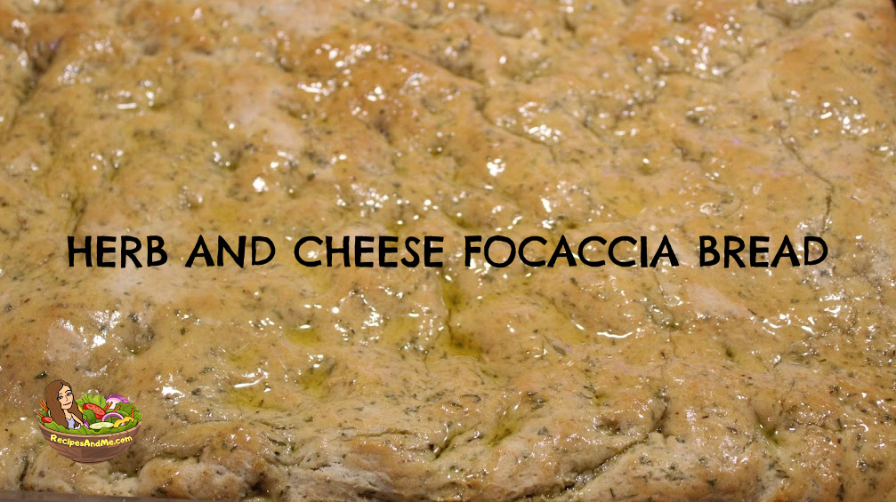 Focaccia bread on sheet pan. Cheese Herb Focaccia Bread Recipe a new family favorite for wholesome homemade bread.  Delicious but simple. RecipesAndMe.com#HerbFocacciaBreadRecipe #FocacciaBreadRecipoe #FocacciaRecipe #HerbFocaccia #RecipesAndMe